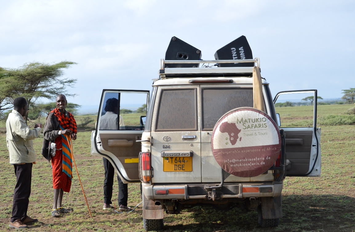 After experiment, talking with a local Maasai who was attracted by playbacks. Photo: Franco Mbise