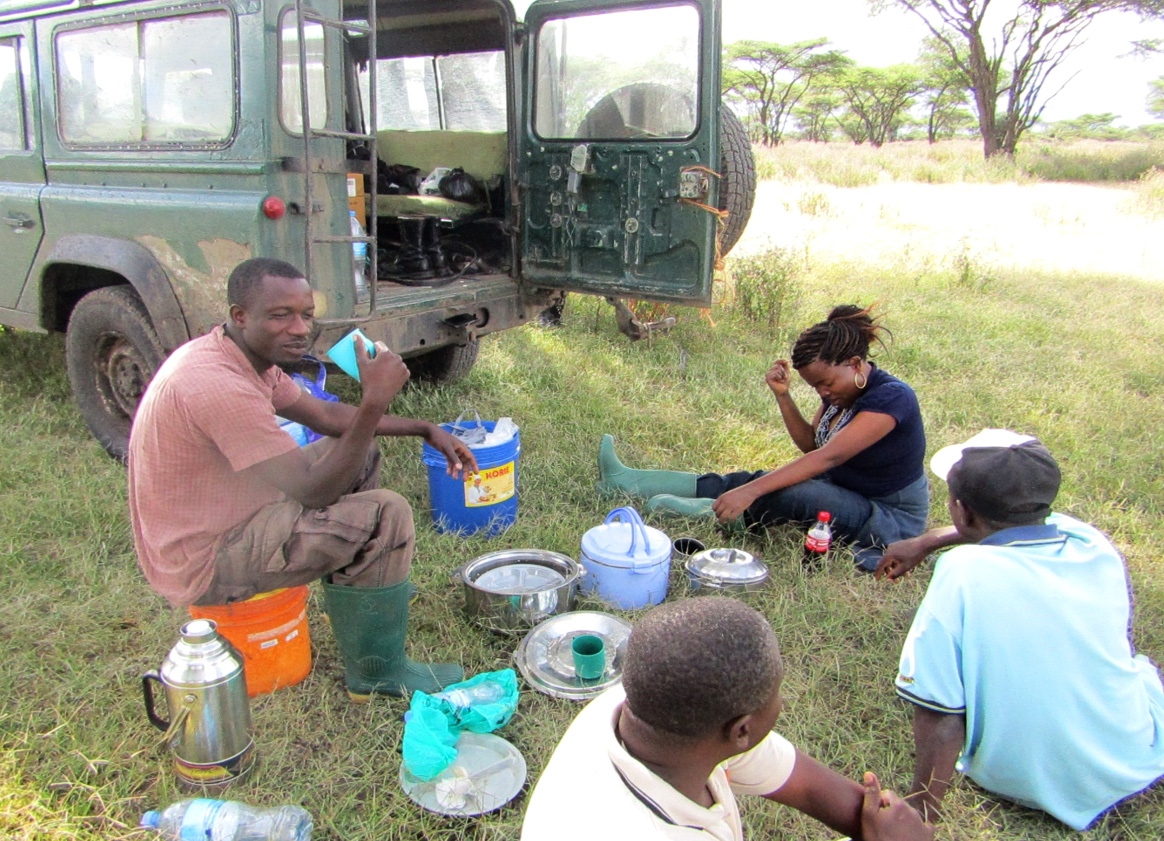 My team having breakfast in Serengeti National Park during preliminary survey 2016. From left; James, (field assistant) Selemani (driver), Greyson and Evelyne (Research officer) Photo; Monica Shilereyo, 2016