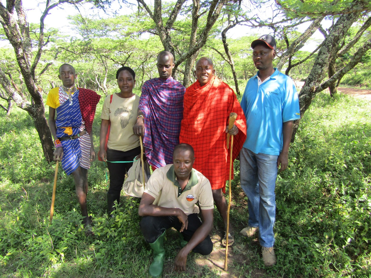 Some villagers (three men with Maasai cloth), TAWIRI officers and I at Ololosokwan village. Photo; Malle, 2016.